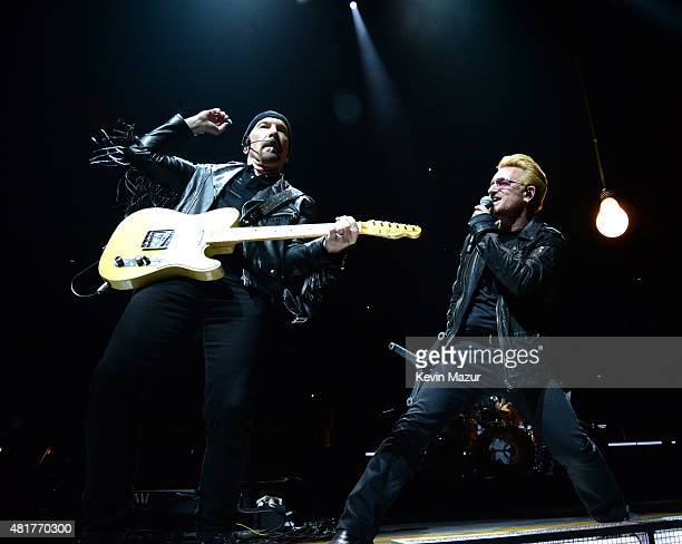 The Edge and Bono perform onstage during U2's 'iNNOCENCE eXPERIENCE' tour at Madison Square Garden on July 23 2015 in New York City