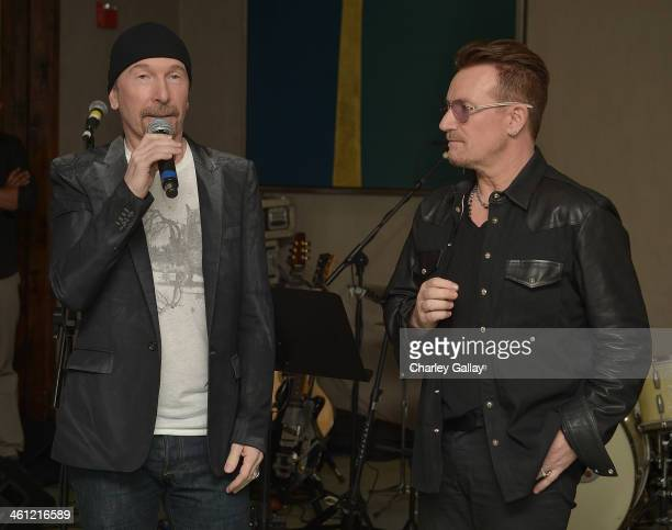 The Edge and Bono speak at The Weinstein Company Hosts A Private Party With U2 In Support Of Their Original Song 'Ordinary Love' From 'MANDELA LONG...