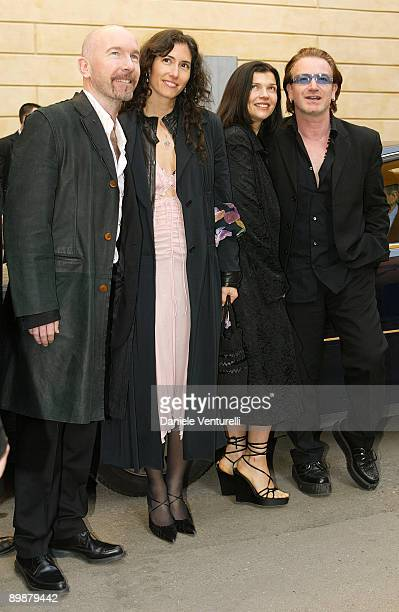 The Edge and wife Morleigh Steinberg with Bono and wife Ali Hewson