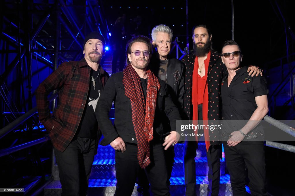 The Edge, Bono, Adam Clayton, Jared Leto and Larry Mullen Jr. pose backstage during the MTV EMAs 2017 held at The SSE Arena, Wembley on November 12, 2017 in London, England.