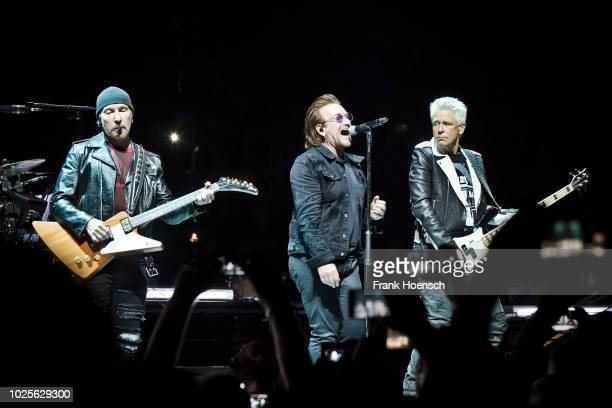 The Edge Bono and Adam Clayton of the Irish band U2 perform live on stage during a concert at the MercedesBenz Arena on August 31 2017 in Berlin...