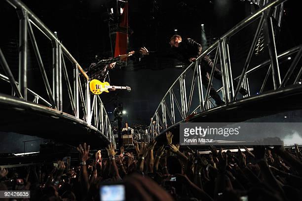 The Edge Bono Larry Mullen Jr and Adam Clayton of U2 perform at Rose Bowl during their U2 360 Tour on October 25 2009 in Pasadena California