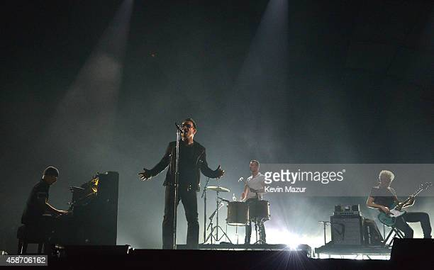 The Edge Bono Larry Mullen Jr and Adam Clayton of U2 perform at the MTV EMA's 2014 at The Hydro on November 9 2014 in Glasgow Scotland