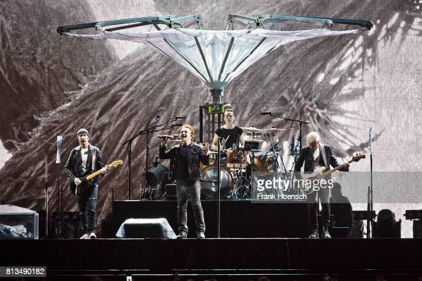 The Edge Bono Larry Mullen Jr and Adam Clayton of U2 perform live on stage during a concert at the Olympiastadion on July 12 2017 in Berlin Germany