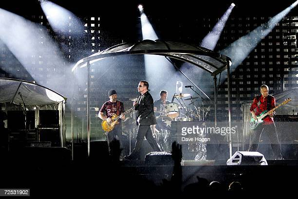 The Edge, Bono, Larry Mullen Jr and Adam Clayton of U2 perform on stage at the first of three rescheduled Sydney dates on their Vertigo Tour, at the...