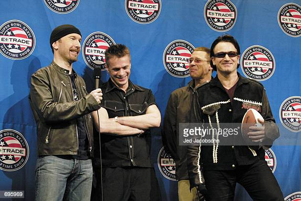 The Edge Larry Mullen Jr Adam Clayton and Bono of U2 answers questions during the Super Bowl XXXVI ETrade Halftime press conference at the New...