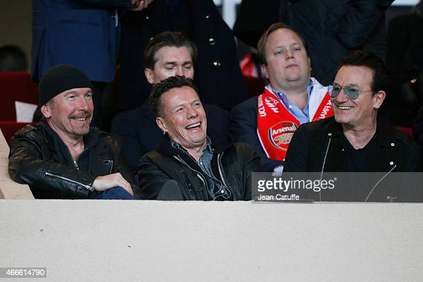 The Edge Larry Mullen Jr and Bono of U2 attend the UEFA Champions League round of 16 match between AS Monaco FC and Arsenal FC at Stade Louis II on...