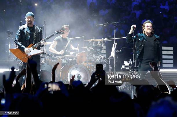 The Edge Larry Mullen Jr and Bono of U2 perform during the eXPERIENCE iNNOCENCE TOUR at the Capital One Arena on June 17 2018 in Washington DC