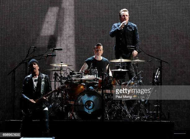 The Edge Larry Mullen Jr and Bono of U2 perform during the 'Joshua Tree Tour 2017' at FedExField on June 20 2017 in Landover Maryland