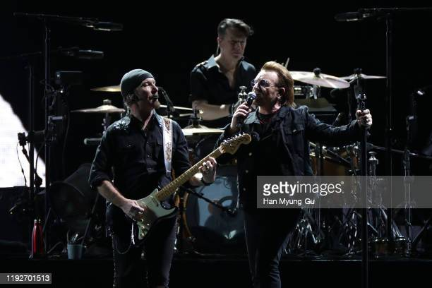 The Edge Larry Mullen Jr and Bono of U2 perform on stage during 'U2 The Joshua Tree Tour 2019' at the Gocheok Sky Dome on December 08 2019 in Seoul...