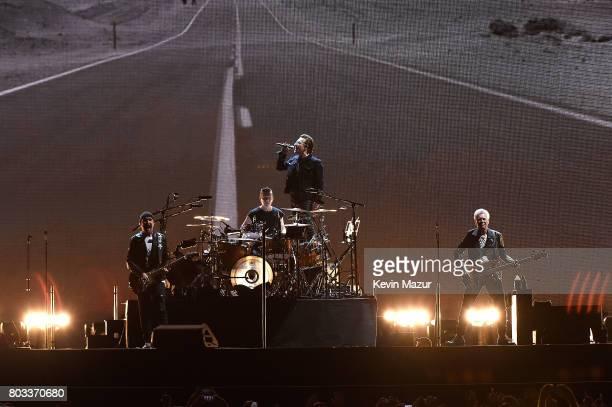 The Edge Larry Mullen Jr Bono and Adam Clayton of U2 perform during U2's 'Joshua Tree Tour 2017' at MetLife Stadium on June 28 2017 in East...