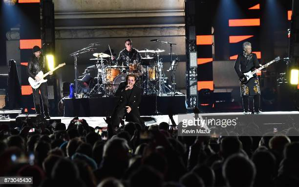 The Edge Larry Mullen Jr Bono and Adam Clayton of U2 perform during the World Stage event as part of the MTV EMAs 2017 at Trafalgar Square on...