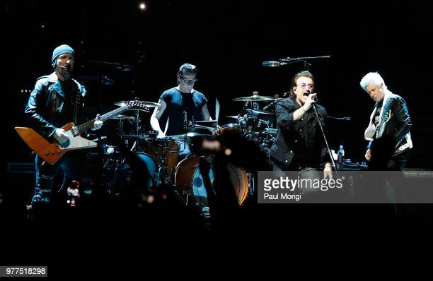 The Edge Larry Mullen Jr Bono and Adam Clayton of U2 perform during the eXPERIENCE iNNOCENCE TOUR at the Capital One Arena on June 17 2018 in...