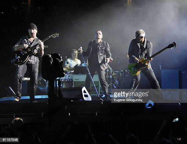 The Edge, Larry Mullen; Jr., Bono and Adam Clayton of U2 perform in concert at Giants Stadium on September 23, 2009 in East Rutherford, New Jersey.
