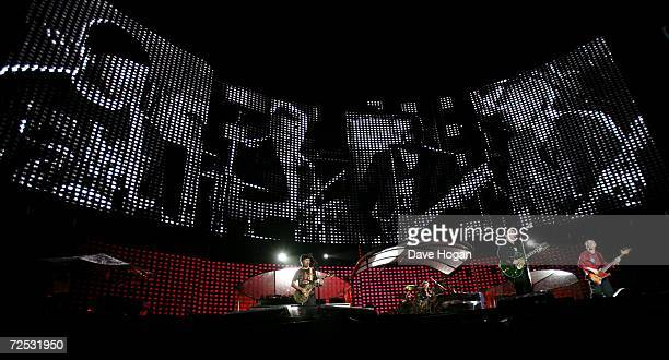 The Edge, Larry Mullen Jr, Bono and Adam Clayton of U2 perform on stage at the first of three rescheduled Sydney dates on their Vertigo Tour, at the...