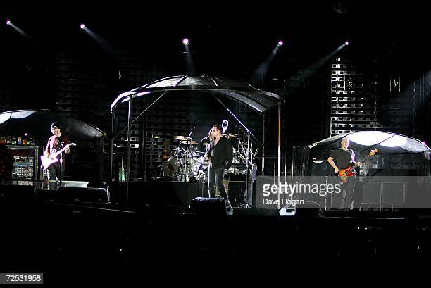 The Edge, Larry Mullen Jr, Bono, and Adam Clayton of U2 perform on stage at the first of three rescheduled Sydney dates on their Vertigo Tour, at the...