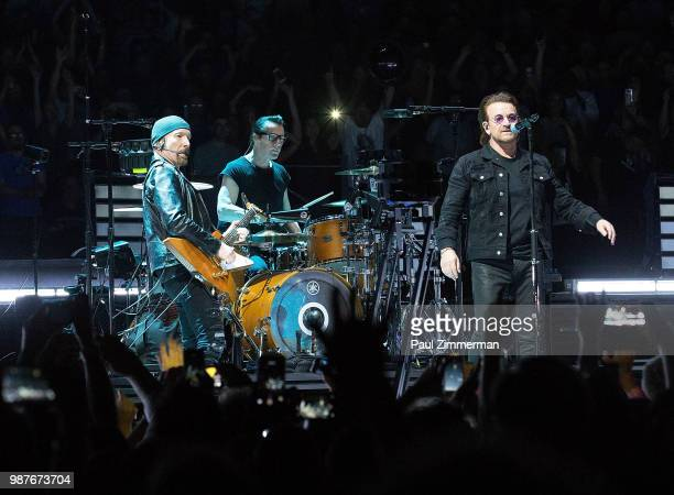 The Edge Larry Mullen Jr Bono and Adam Clayton of U2 perform onstage during the eXPERIENCE iNNOCENCE TOUR at Prudential Center on June 29 2018 in...