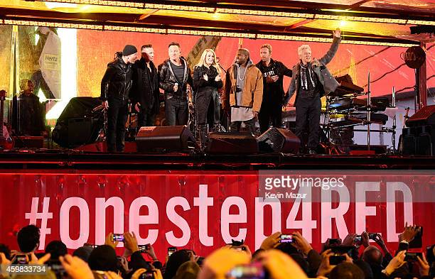The Edge Larry Mullen Jr Bruce Springsteen Carrie Underwood Kanye West Chris Martin and Adam Clayton pose onstage on World AIDS Day at 'A Thank You...