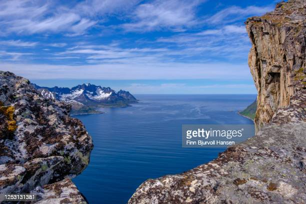 the edge of the cliff at trailhead hesten in fjordgard at the island senja in northern norway - finn bjurvoll stock pictures, royalty-free photos & images