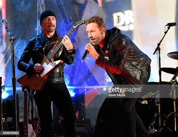 The Edge of U2 and Chris Martin perform on World AIDS Day at 'A Thank You Presented by RED on December 1 2014 in New York City Photo by Kevin...