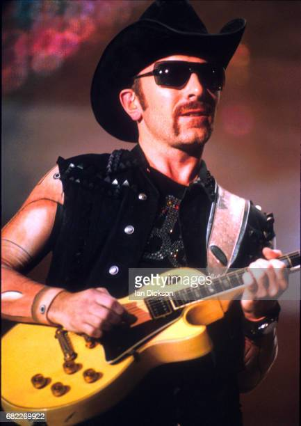 The Edge of U2 performing on stage at Wembley Stadium London 22 August 1997