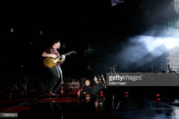 The Edge of U2 performs on stage at the first of three rescheduled Sydney dates on their Vertigo Tour at the Telstra Stadium on November 10 2006 in...