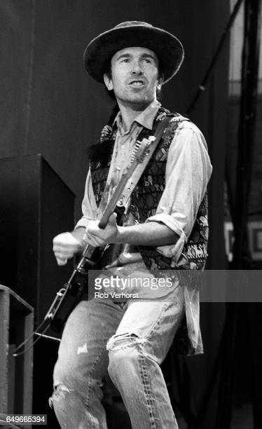 The Edge of U2 performs on stage on The Joshua Tree Tour at Feyenoord Stadion De Kuip Rotterdam Netherlands 10th July 1987
