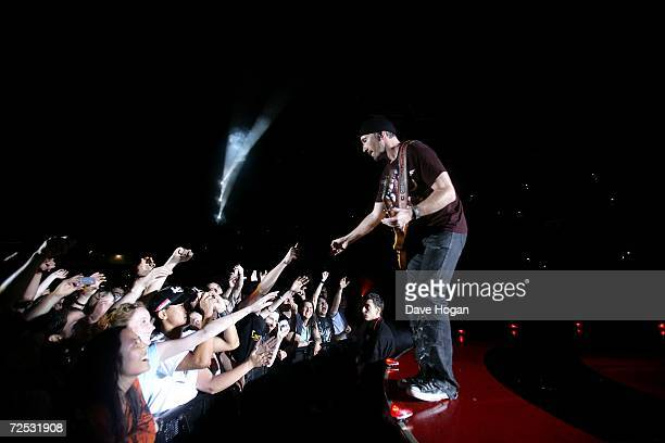 The Edge of U2 reaches out to the crowd as he performs on stage at the first of three rescheduled Sydney dates on their Vertigo Tour at the Telstra...