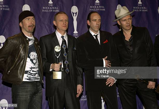 The Edge of U2 with Terry Chimes, Mick Jones and Paul Simonon of The Clash