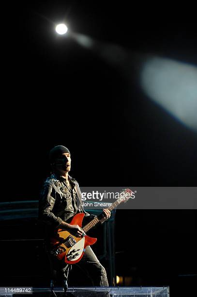 The Edge performs during the U2 360 Tour at INVESCO Field at Mile High on May 21 2011 in Denver Colorado