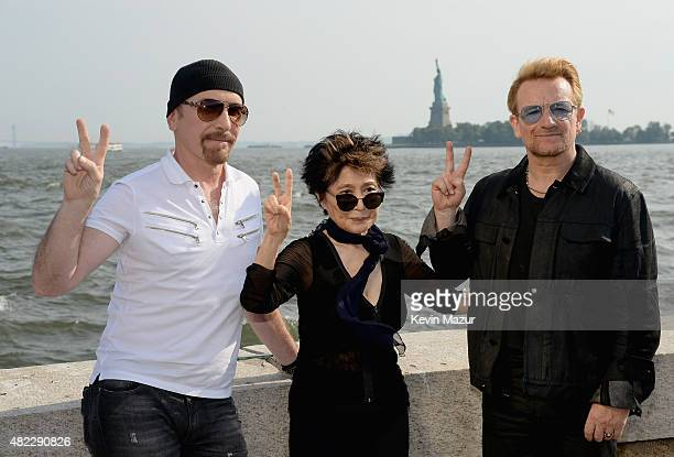 The Edge Yoko Ono and Bono attend Amnesty International Tapestry Honoring John Lennon Unveiling at Ellis Island on July 29 2015 in New York City