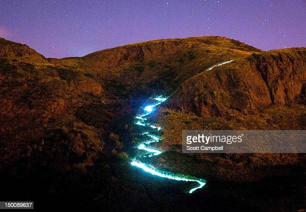The Edinburgh International Festival is launched with the Speed of Light, a choreographed public art piece on Arthur's Seat involving endurance...