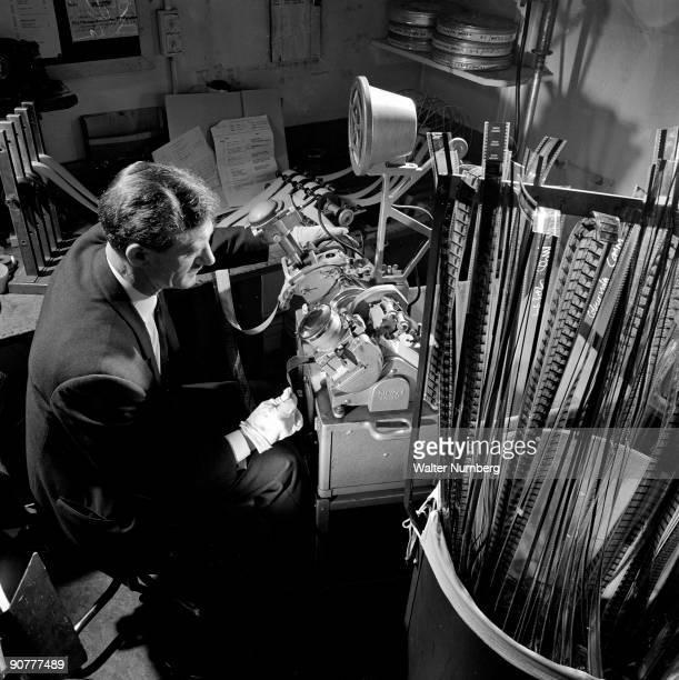 The editing room of Guild Television Services a small production and facility company specialising in commercials An editor runs lengths of 35mm film...