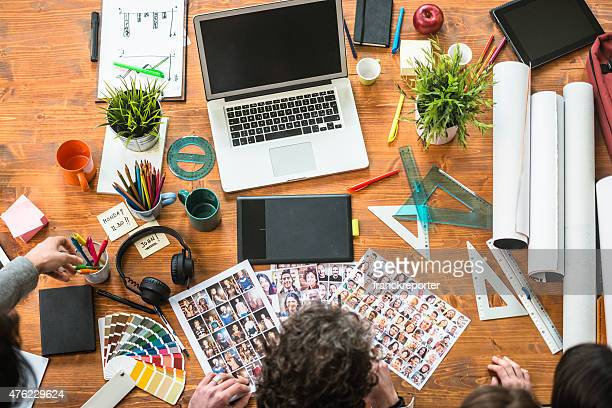 the editor at work choosing the right image - design studio stock pictures, royalty-free photos & images