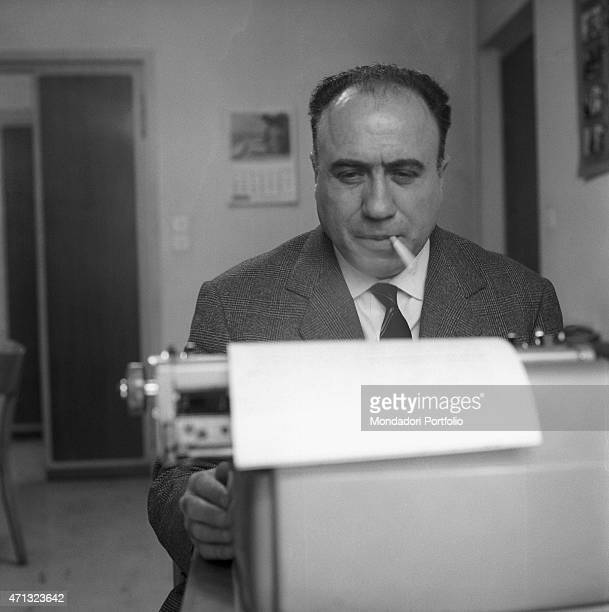 The editor of the magazine Epoca Livio Pesce typewriting an article. 21st October 1963