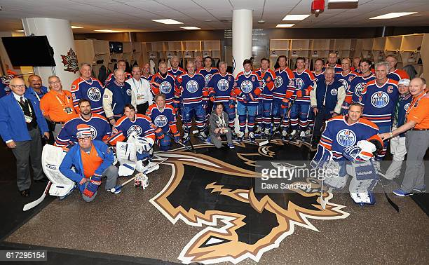 The Edmonton Oilers alumni team pose in the locker room before playing in the 2016 Tim Hortons NHL Heritage Classic Alumni Game against the Winnipeg...