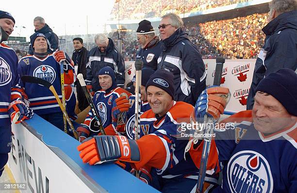 The Edmonton Oilers bench takes a break during the Molson Canadien Heritage Classic against the Montreal Canadiens on November 22 2003 at...