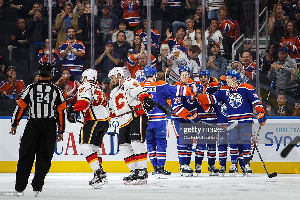 The Edmonton Oilers celebrate a goal against the Calgary Flames in an NHL preseason game on September 26, 2016 at Rogers Place in Edmonton, Alberta, Canada.