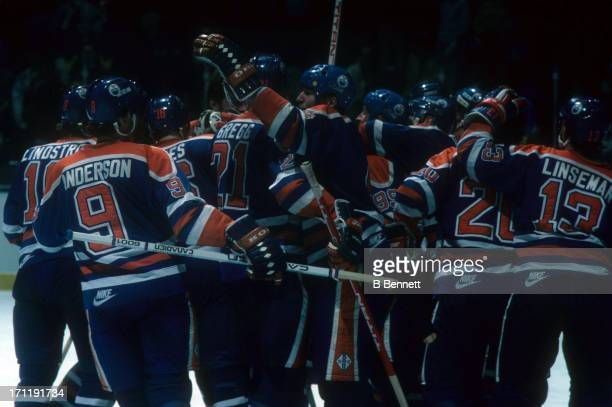 The Edmonton Oilers celebrate their victory after the game against the New York Islanders during the 1984 Stanley Cup Finals in May 1984 at the...