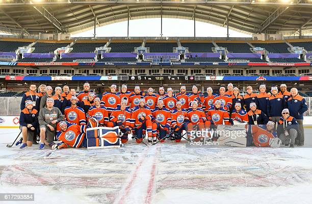 The Edmonton Oilers pose for a photo in advance of the 2016 Tim Hortons NHL Heritage Classic game at Investors Group Field on October 22 2016 in...
