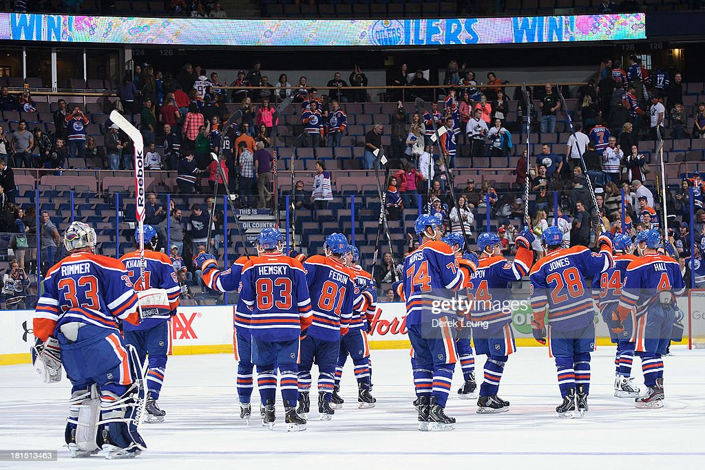 The Edmonton Oilers raise their sticks after defeating the Vancouver Canucks during a preseason NHL game at Rexall Place on September 21, 2013 in Edmonton, Alberta, Canada.