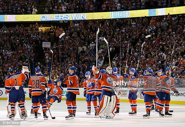 The Edmonton Oilers salute the fans after defeating the Vancouver Canucks on April 6 2016 at Rexall Place in Edmonton Alberta Canada The game is the...