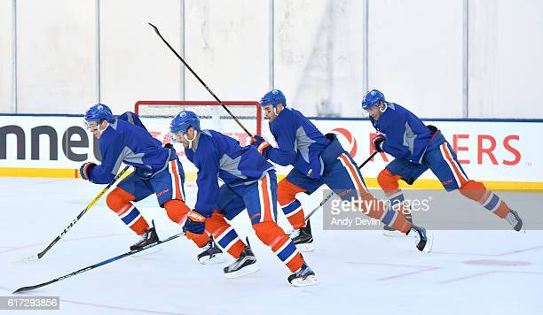 The Edmonton Oilers skate during practice in advance of the 2016 Tim Hortons NHL Heritage Classic game at Investors Group Field on October 22 2016 in...