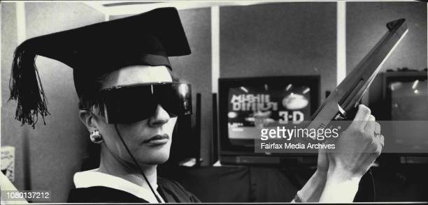 The Educator' Sally Levette 37 of Casula who was acting as a host at the Toltoys exhibit pictured with the Saga Master system a 3D video gameThe...