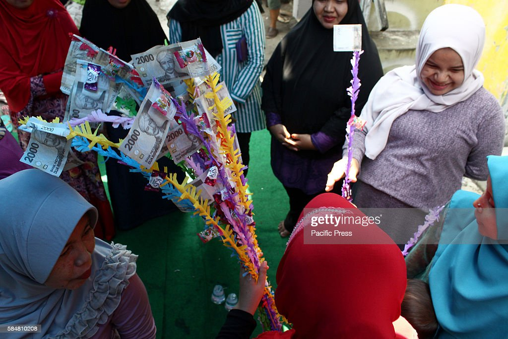 The Edwin family partake in a ceremony called Akikah (in... : News Photo