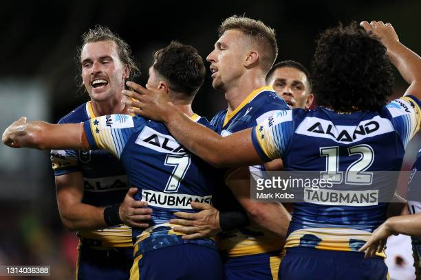 The Eels celebrate a try during the round seven NRL match between the Parramatta Eels and the Brisbane Broncos at TIO Stadium, on April 23 in Darwin,...