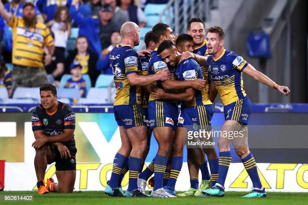 The Eels celebrates a try scored by Brad Takairangi of the Eels during the round Eight NRL match between the Parramatta Eels and the Wests Tigers at...