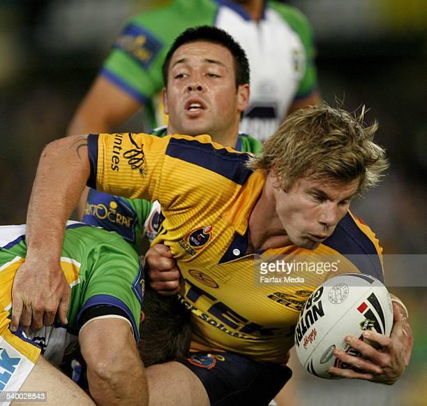 The Eels' Glenn Morrison is brought down by the Raiders' defence during the NRL Round 9 rugby league match between the Parramatta Eels and Canberra...