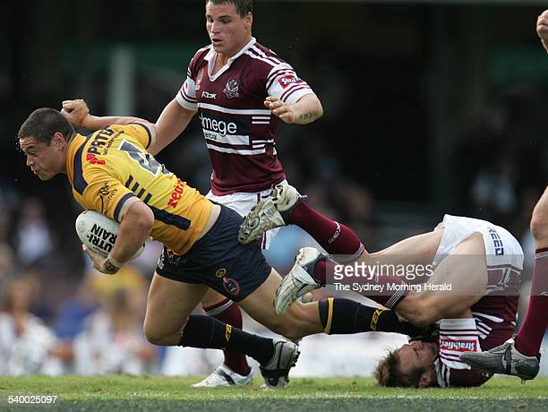 The Eels' Timana Tahu runs over top of Manly's Brett Stewart during the Round 8 NRL rugby league match between the Manly Sea Eagles and Parramatta...