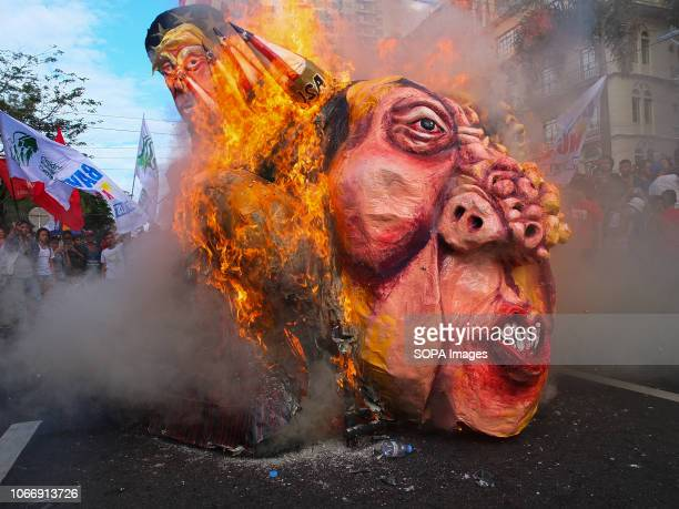 The effigy of President Duterte seen burning during the protest Leftist groups stage Bonifacio Day of protest in Mendiola and at the US Embassy in...